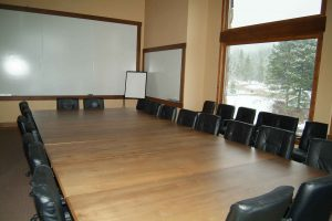Alpine Villa Amenities Conference Room, configurable table, 28 conference chairs, equipped with electronics and whiteboard, beverage bar, mini-frig