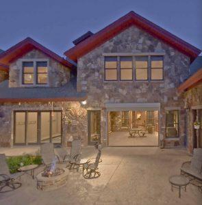 Alpine Villa Rear Patio, gas firepit, patio furniture, electric door opens to indoor grill room