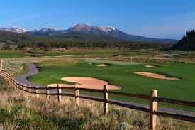 Breckenridge Golf Course, public 27-hole golf course, lush green with sand traps, cart path, and mountain backdrop