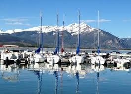 Alpine Villa Activities Sailing Lake Dillon, 5 sailboats docked on peaceful Lake Dillon with mountain backdrop